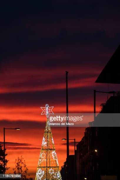 An illuminated Christmas tree in Atocha near the Reina Sofia Museum during sunset The city of Madrid has turned on the Christmas lights for the...