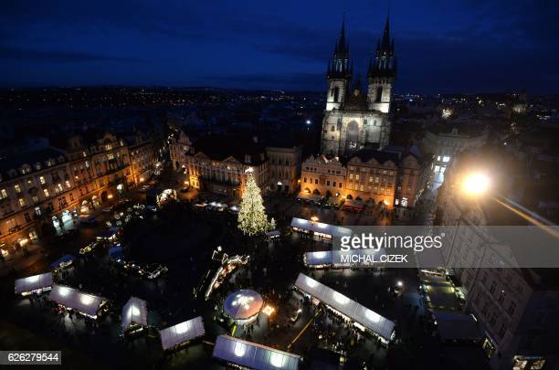 An illuminated Christmas tree is seen at the market at the Old Town Square in Prague Czech Republic on November 28 2016 / AFP PHOTO / Michal Cizek