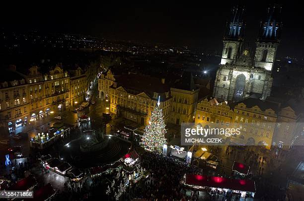 An illuminated christmas tree is seen at the Old Town Square in Prague on December 17 2012 AFP PHOTO/MICHAL CIZEK