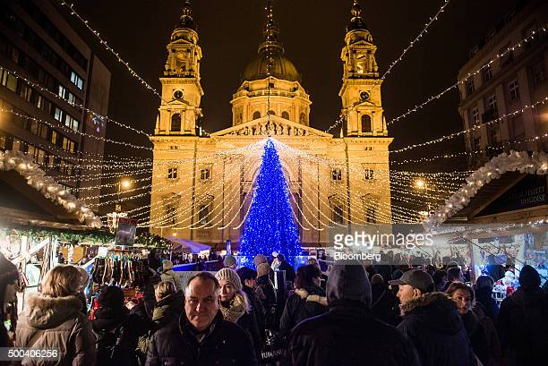 An illuminated Christmas tree stands in front of St Stephen's Basilica at a Christmas market in Budapest Hungary on Monday Dec 7 2015 Hungary GDP...
