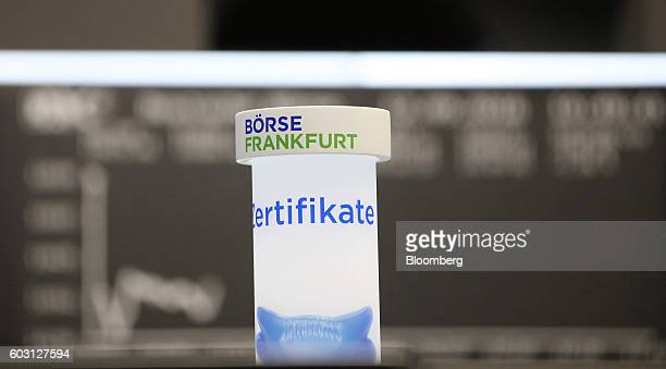 An illuminated column stands on a trader's desk inside the Frankfurt Stock Exchange in Frankfurt Germany on Monday Sept 12 2016 EON SE cut most ties...