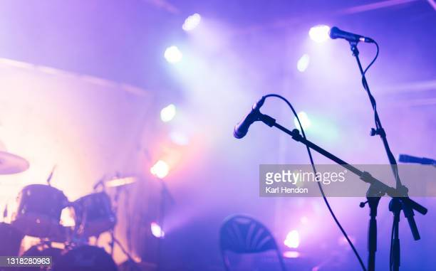 an illuminated concert stage - stock photo - concert stock pictures, royalty-free photos & images