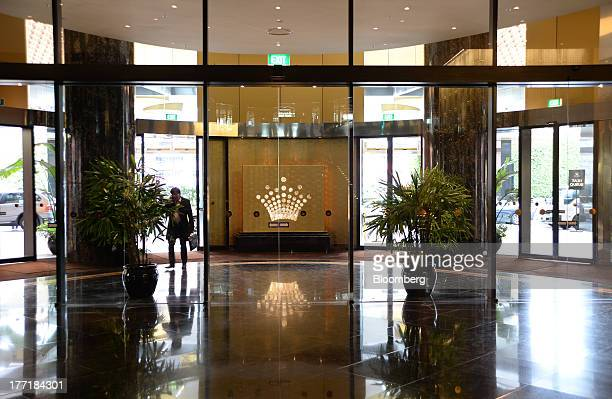 An illuminated Crown Ltd logo is displayed inside the Crown Towers hotel part of the Crown Melbourne casino and entertainment complex in Melbourne...