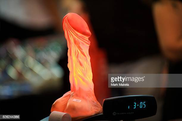 An illuminated dildo stands at attention during Erotica 2009 an annual threeday event sponsored by the sex industry at the Kensington Olympia...