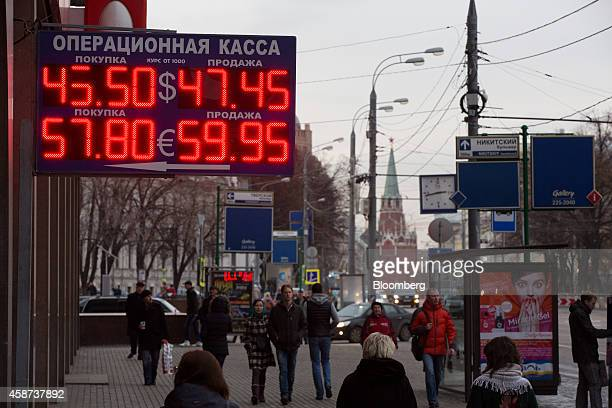 An illuminated euro currency sign displays the exchange rates for dollar and euro currencies against the Russian ruble outside a currency exchange...
