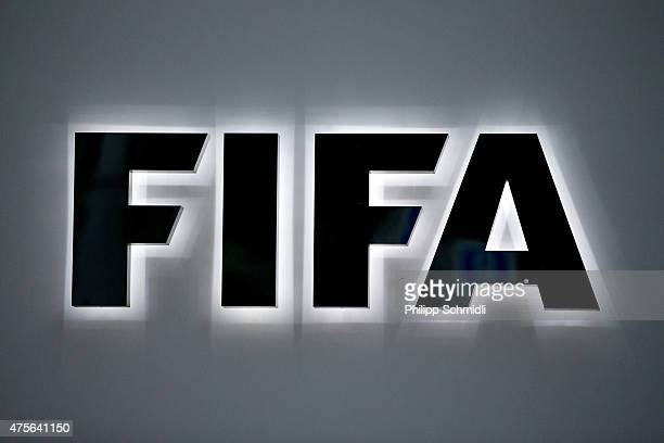 An illuminated FIFA logo sits on a sign at the FIFA headquarters on June 2 2015 in Zurich Switzerland Joseph S Blatter resigned as president of FIFA...
