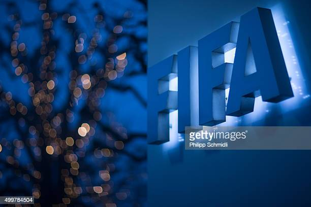 An illuminated FIFA logo sits on a sign at the FIFA headquarters on December 3 2015 in Zurich Switzerland