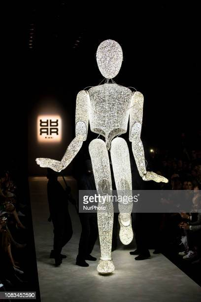 An illuminated figure performs before Riani Fashion Show during Mercedes Benz Fashion Week Berlin Autumn/Winter 2019at E-Werk in Berlin on January...