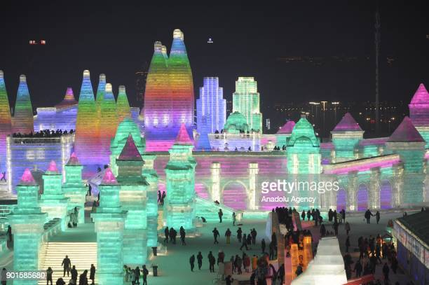 An illuminated ice castle is seen during the Harbin International Ice and Snow Sculpture Festival at Harbin Sun Island International Snow Sculpture...