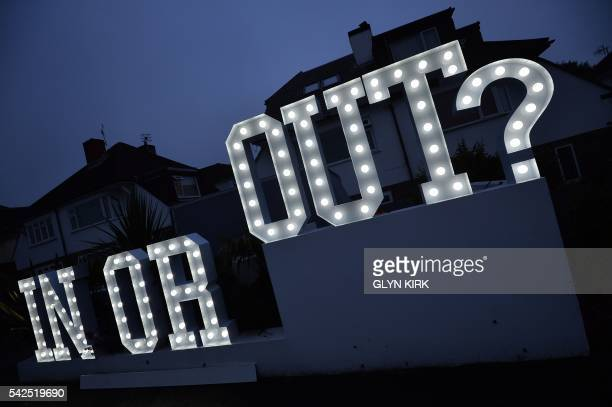 An illuminated In or Out sign is pictured outside a house in Hangleton near Brighton in southern England on June 23 as Britain holds a referendum on...