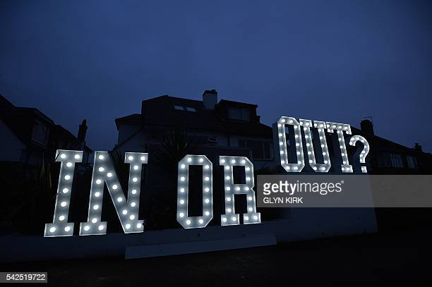 An illuminated 'In or Out' sign is pictured outside a house in Hangleton near Brighton in southern England on June 23 as Britain holds a referendum...