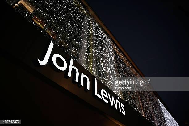 An illuminated logo sits above the entrance to a John Lewis Plc department store on Oxford Street in London UK on Saturday Nov 29 2014 UK consumer...