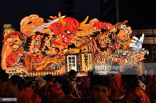 An illuminated Nebuta float marchs on during the Aomori Nebuta festival on August 6 2009 in Aomori Japan