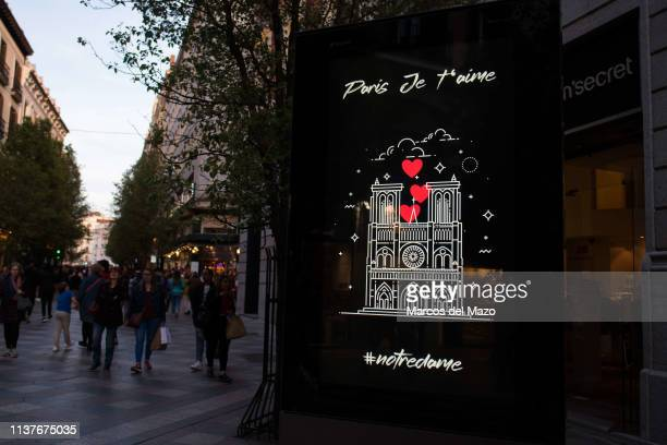 An illuminated panel used for advertising shows an image of the Cathedral of Notre Dame of Paris as a sign of solidarity after the fire.