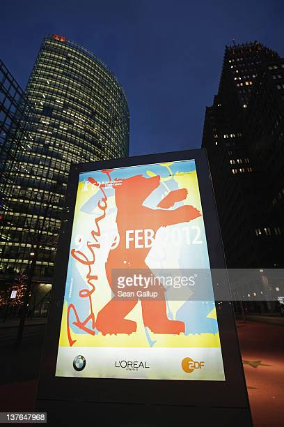 An illuminated poster announces the 62nd Berlinale International Film Festival near Potsdamer Platz on January 24 2012 in Berlin Germany The...