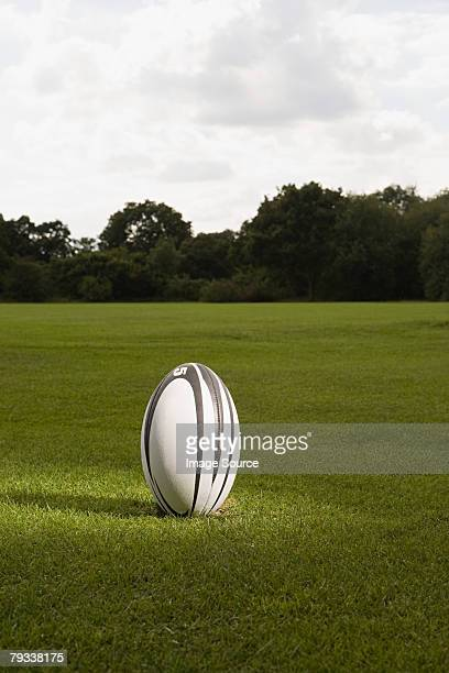 An illuminated rugby ball on a rugby pitch
