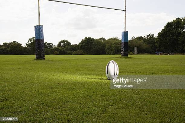 an illuminated rugby ball on a rugby pitch - rugby stock pictures, royalty-free photos & images