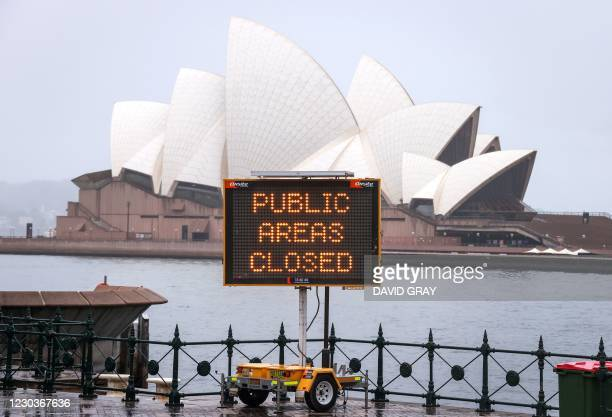 An illuminated sign is displayed in front of the Opera House as part of COVID-19 restrictions for New Year celebrations around Circular Quay in...