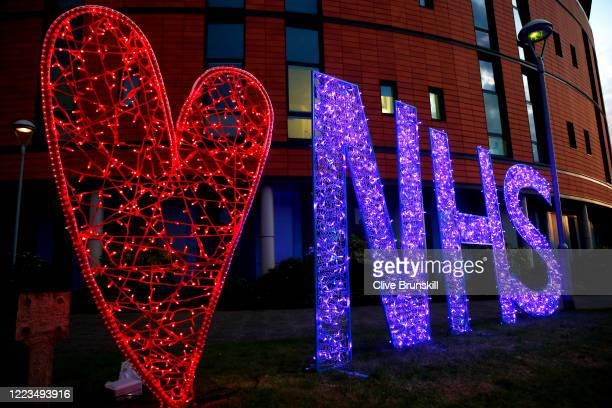 An illuminated sign showing a heart and the letters NHS after the applause for key workers at Salford Royal Hospital on May 07, 2020 in Salford,...