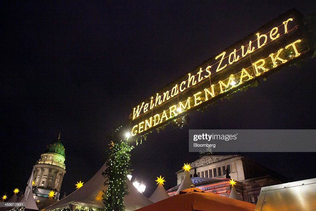 An illuminated sign sits above a market ahead of Christmas in Berlin, Germany, on Sunday, Dec. 1, 2013. Euro-area economic growth slowed to 0.1 percent in the third quarter after a 0.3 percent gain in the previous three months. Photographer: Krisztian Bocsi/Bloomberg via Getty Images