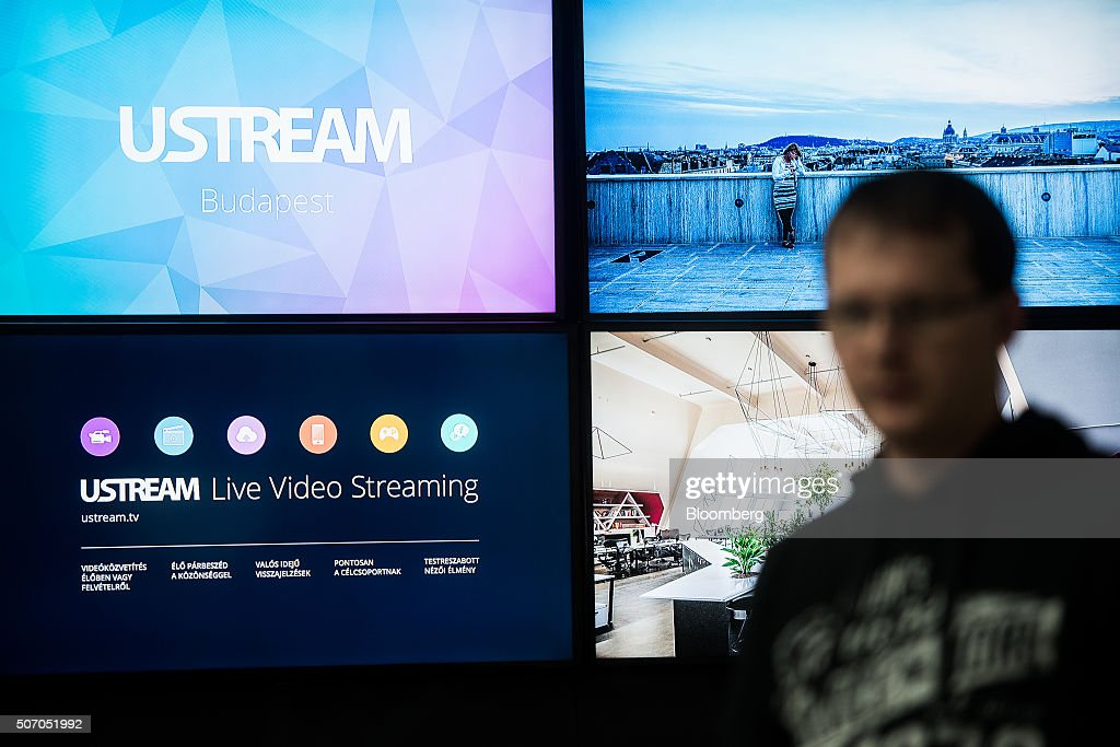 An illuminated sign sits on the wall inside the Ustream, Inc. office in Budapest, Hungary, on Tuesday, Jan. 26, 2016. International Business Machines Corporation (IBM) is buying live video stream provider Ustream to help sell more video services to clients including the National Football League, HBO and the Food Network, through its cloud platform. Photographer: Akos Stiller/Bloomberg via Getty Images
