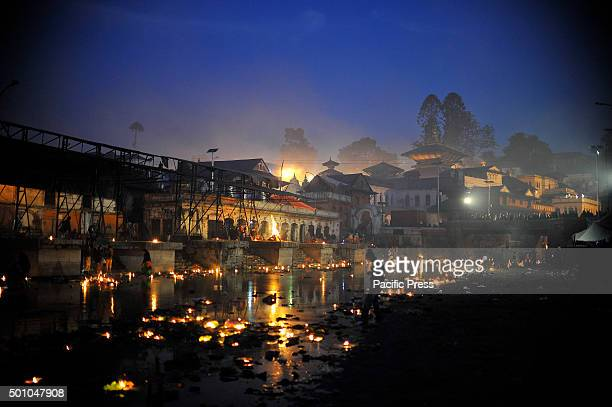 KATHMANDU NEPAL KATHMANDU NP NEPAL An illuminated view of Pashupatinath Temple along with the floating oil lamps at Bagmati river at the...