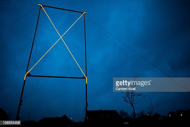 An illuminated X the traditional symbol in this of the 33years old protest in this countryside against the nuclear waste transports stands in the...