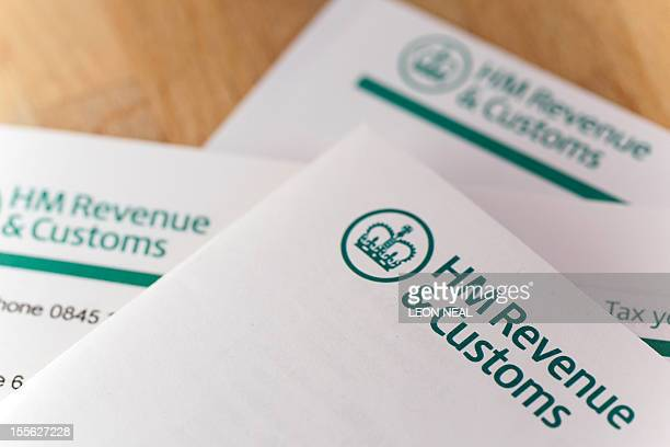 An illustartion of tax return forms in London on November 6 2012 AFP PHOTO / LEON NEAL