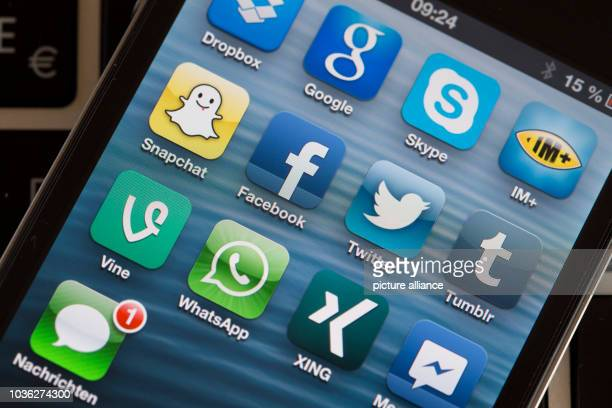 An illustration dated 12 April 2013 shows the display of a smartphone with the app logos of various social media plattforms in Schwerin Germany...