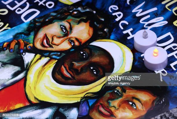 An illustration depicting Nebra Hassanen in the middle is seen during a commemoration ceremony at the Federal Plaza in Chicago IL United States on...