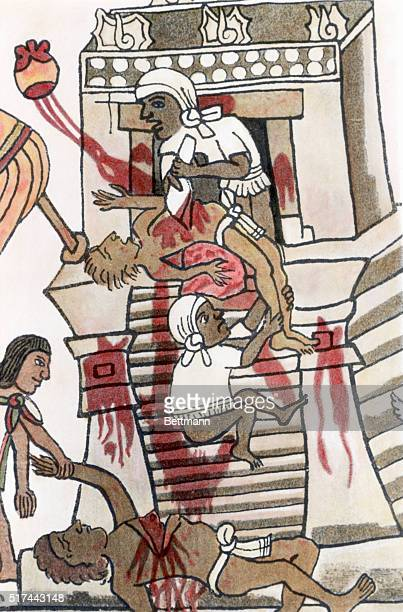 An illustration of an Aztec priest offering the beating human heart of a sacrifice victim to the war god Huitzilopochtli From the Codex Magliabecchi...