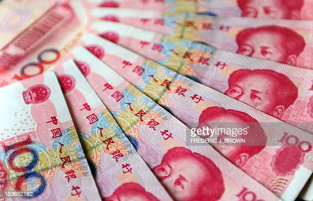 An illustration of Chinese currency 100 yuan notes issued by the People's Bank of China fronted with an image of former Communist party leader Mao...