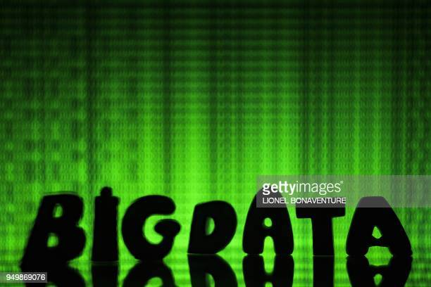 """An illustration photo taken on April 21, 2018 in Paris shows letters composing the word """"big data""""."""