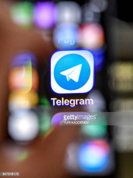 An illustration picture taken through a magnifying glass on April 17 2018 in Moscow shows the icon of the popular messaging app Telegram on a smart...