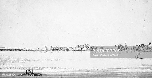An illustration providing a view of Giza from the Nile River a man on log and plank raft is seen rowing in the foreground while a small sailboat can...