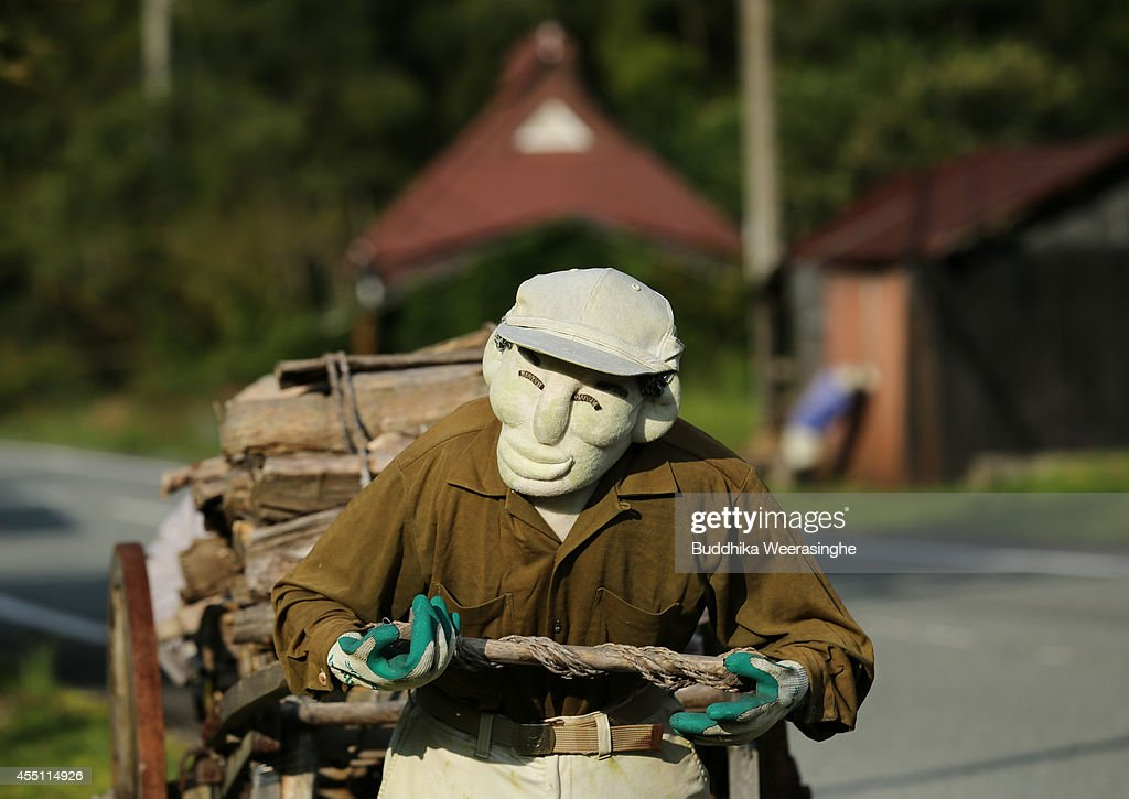 An illustration showing a scarecrow pulling a firewood cart beside a road is on display at Kakashi no Sato, or the Scarecrow's Hometown on September 10, 2014 in Himeji, Japan. In this district of Yasutomi in Himeji city, over 100 of scarecrows stand in farmlands and abandoned houses to illustrate the good old Japanese countryside and attract visitors.