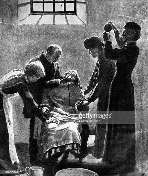 An illustration showing prison wardens force feeding a hunger striking suffragette in Holloway Prison