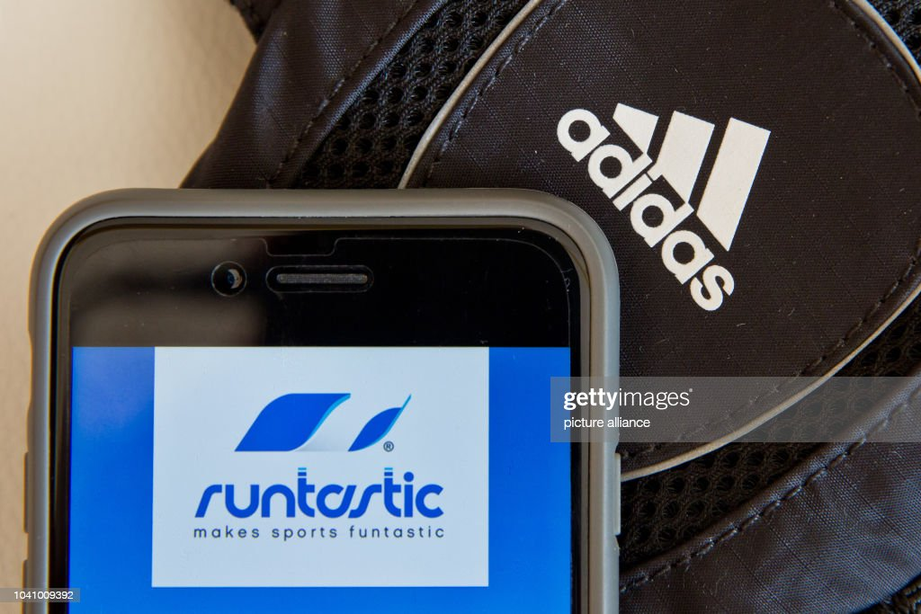 5da0483f94f ILLUSTRATION - An illustration shows a mobile phone running the sports  application Runtastic pictured next to