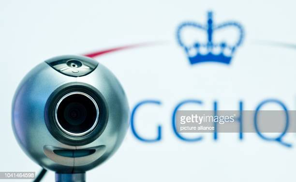 ILLUSTRATION An illustration shows a webcam in front of the logo of the British intelligence agency Government Communications Headquarters in...