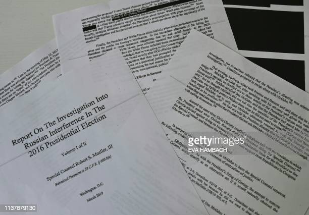 An illustration shows printed pages of the Mueller Report at an office on April 18 in Washington DC US Attorney General Bill Barr said Thursday that...