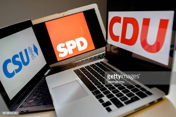 An illustration shows the logo of the German parties CDU SPD and CSU on laptop displays on January 11 2018 in Berlin Germany