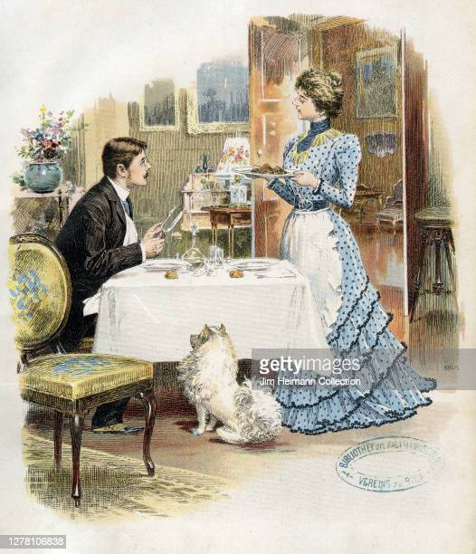 An illustrations shows a woman bringing a plate of food to a man who sits at a table with a dog begging at his feet, circa 1900.