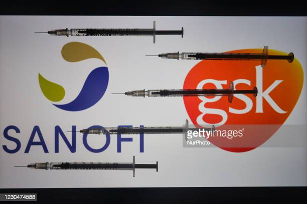 An illustrative image of medical syringes in front of GSK-Sanofi logo displayed on a screen. On Friday, January 8 in Dublin, Ireland.
