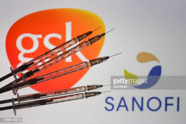 An illustrative image of medical syringes in front of GSK-Sanofi logos displayed on a screen. On Friday, January 8 in Dublin, Ireland.