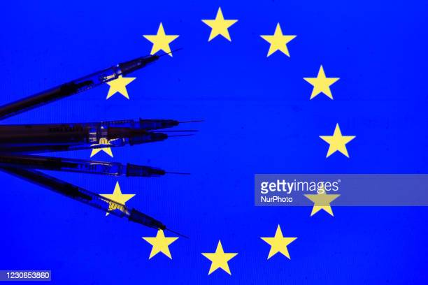 An illustrative image of medical syringes in front of the flag of the European Union displayed on a screen in the background. On Monday, January 18...