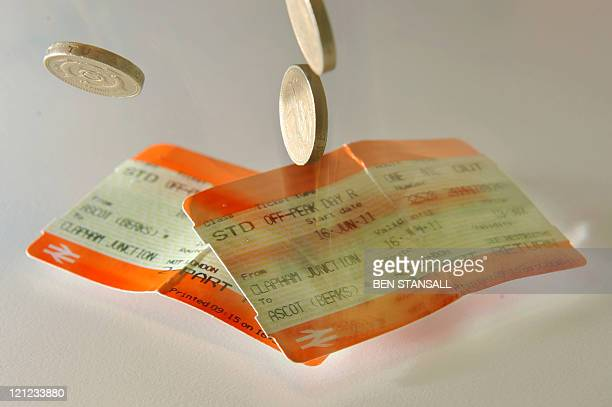 An illustrative image shows rail tickets and British pound coins in London on August 16 2011 British train commuters are facing rail ticket rises of...
