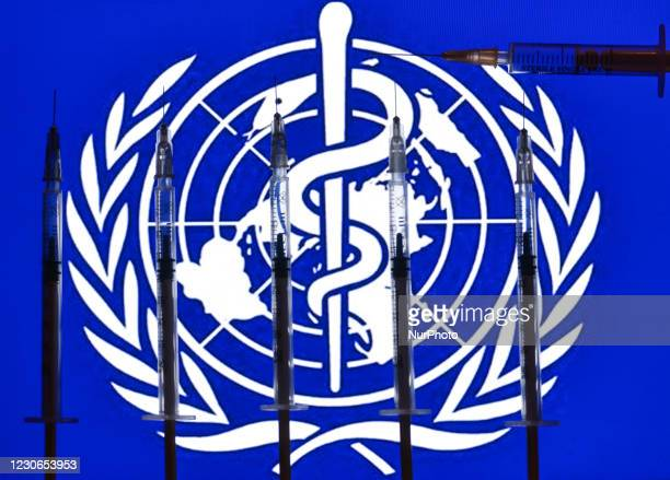 An illustrative photo showing medical syringes seen in front of the World Health Organization flag displayed on a screen. On Monday, January 18 in...