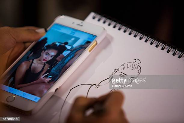 An illustrator draws a picture based on the models backstage at Milk Studios on September 11 2015 in New York City