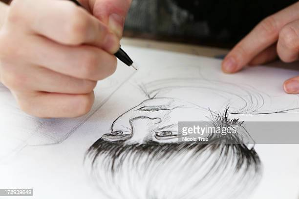 an illustrator working on a drawing - illustrator stock photos and pictures
