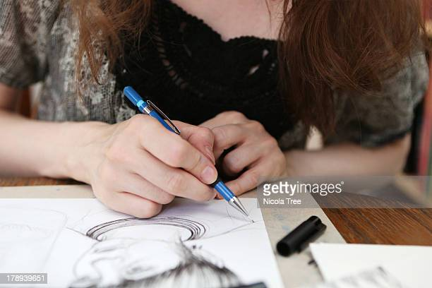 an illustrator working on an illustration - illustrator stock photos and pictures